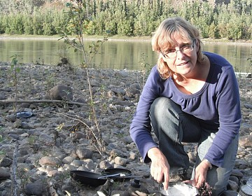 Jocelyn making bannock on Stewart River